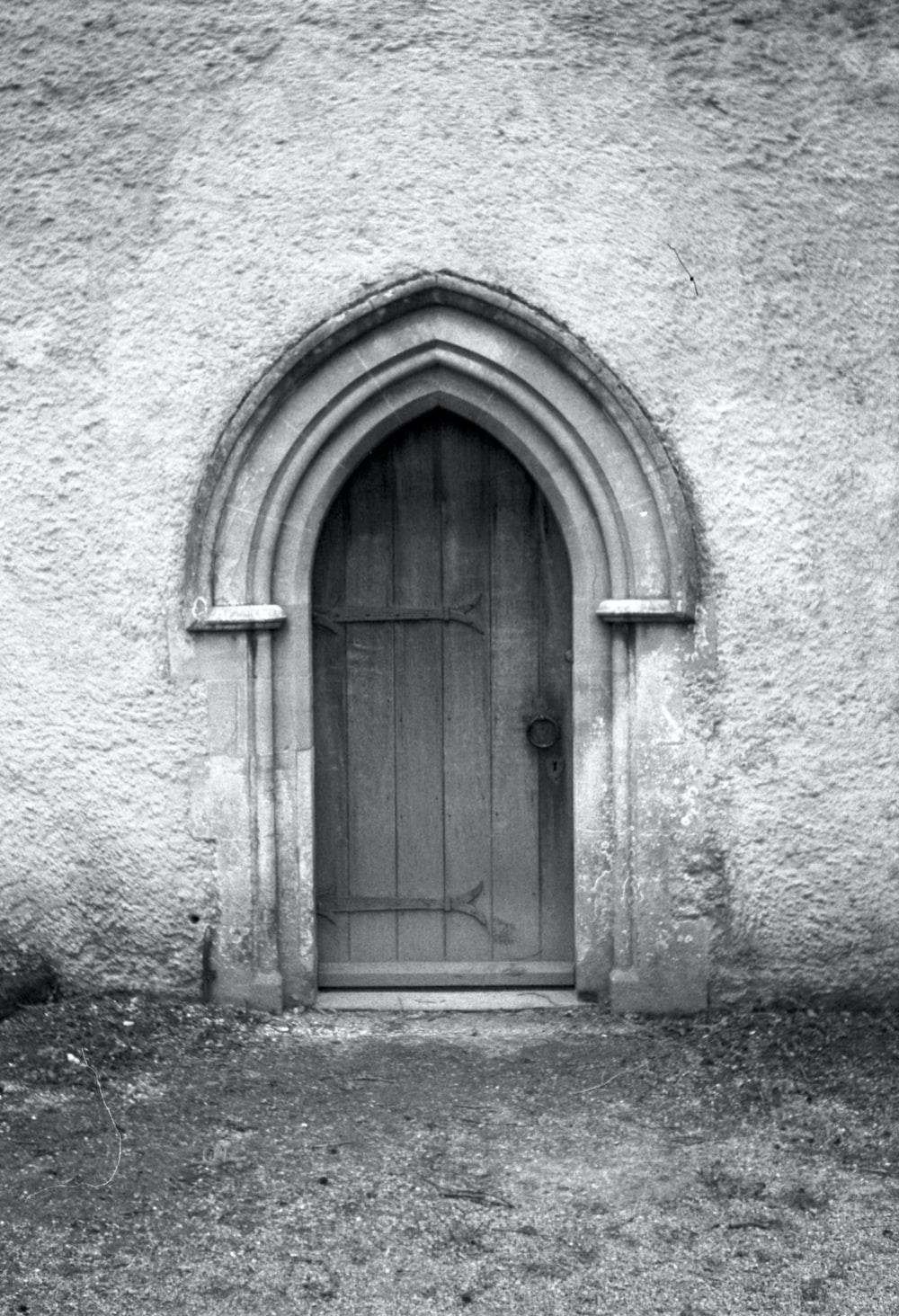 wooden door with concrete wall