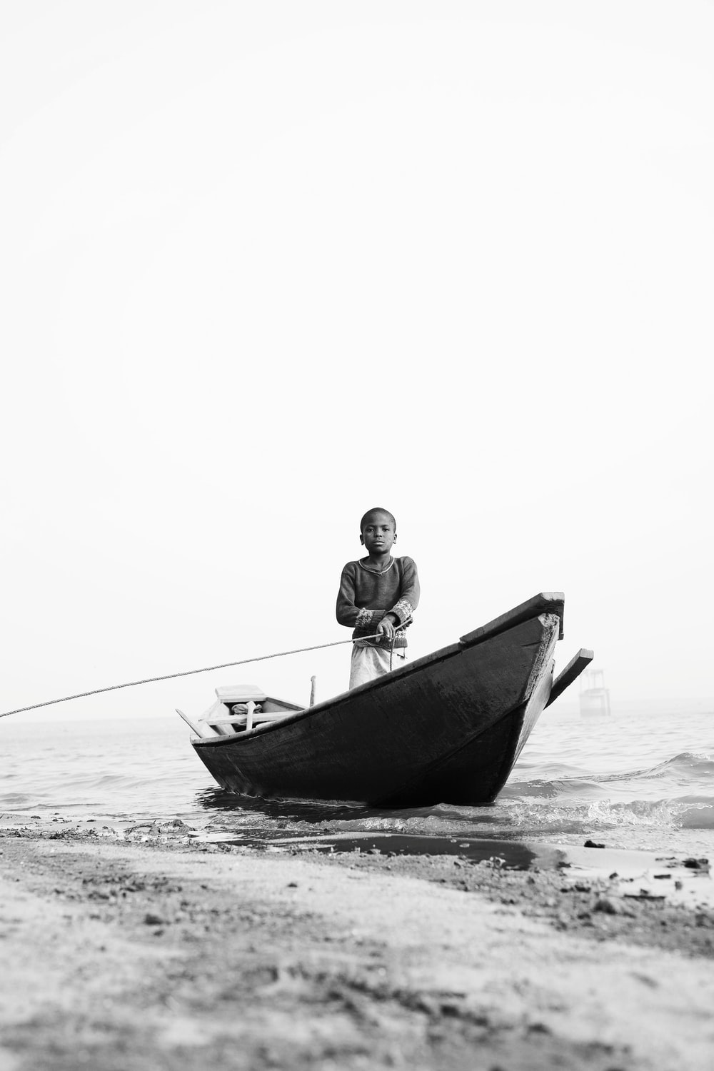 grayscale photography of toddler riding on gondola