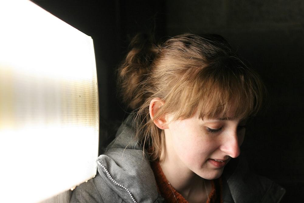 woman in grey hoodie in room
