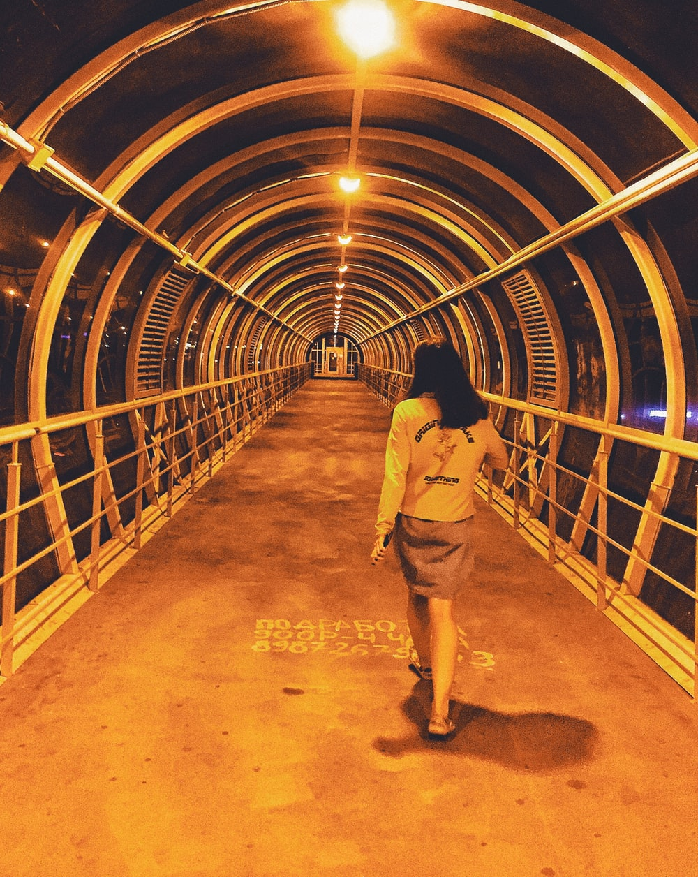 woman in a covered footbridge