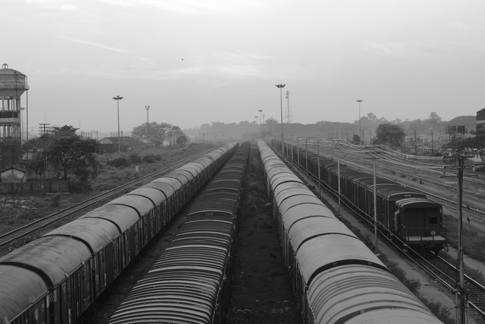 grayscale photo of trains