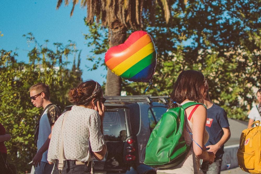women walking near car