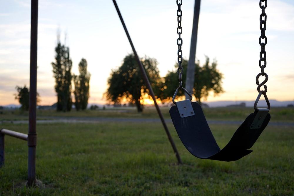 swing across green trees