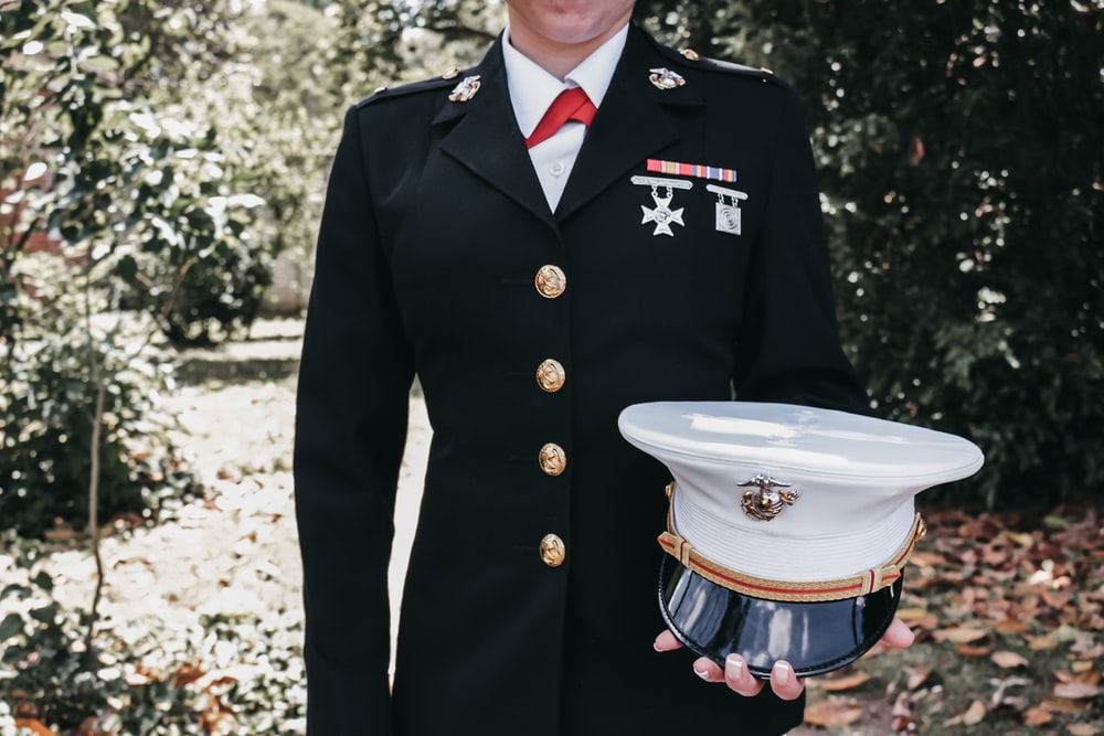 man holding cap outside