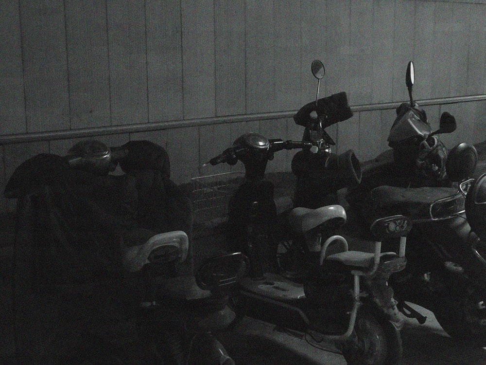 grayscale photo of motorcycles