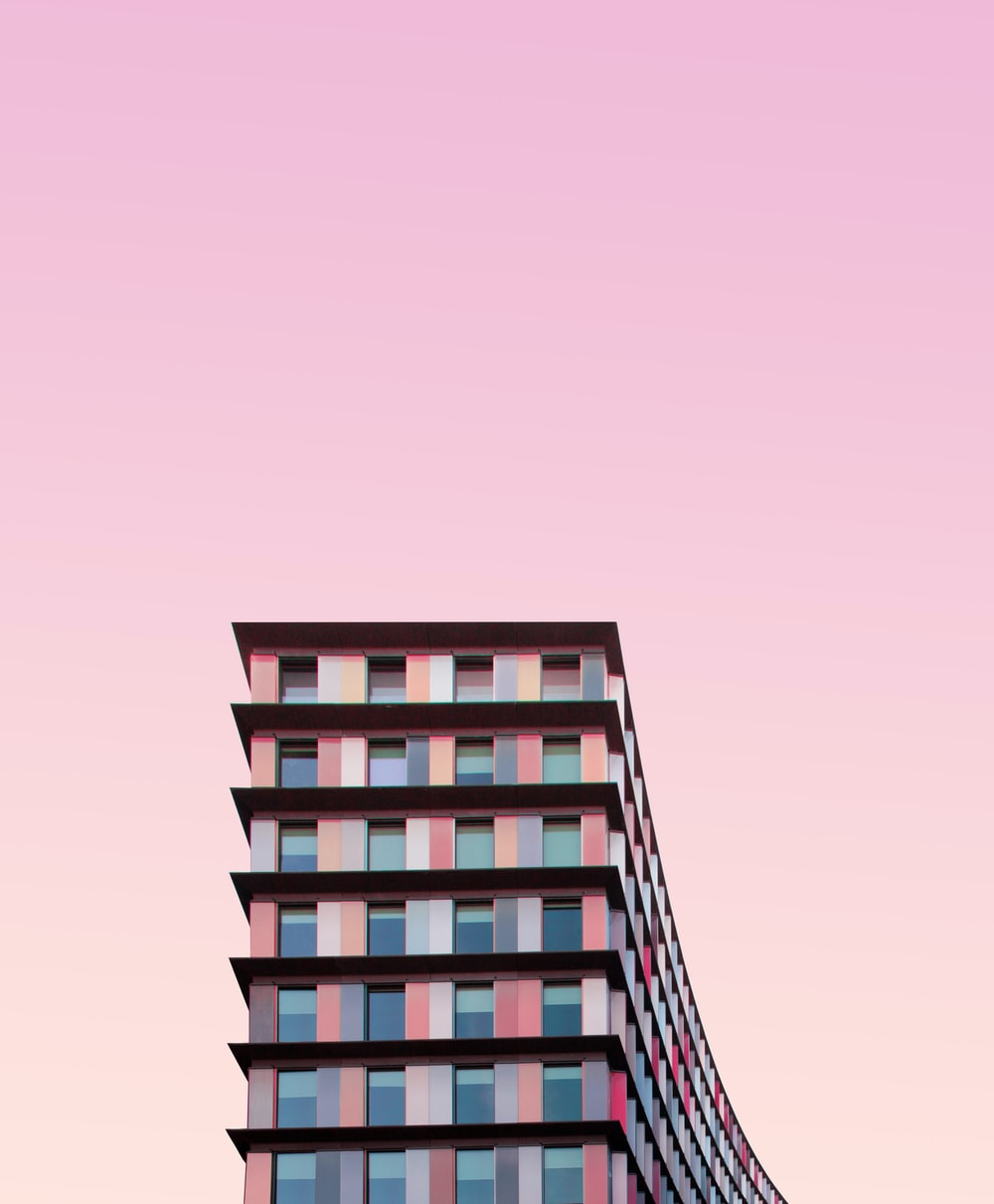 white and pink concrete building during daytime