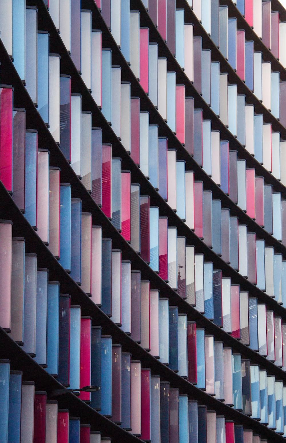 multicolored books on rack