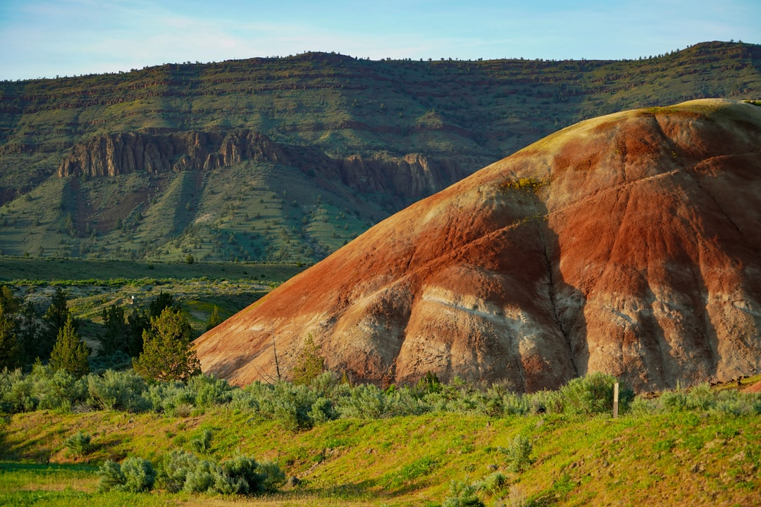 Final photo of my Painted Hills collection. This is another viewpoint often overloooked by photographers. This is toward the entrance to the national monument if you're coming from the tiny town of Mitchell. Bonus points for that rockin' tectonic uplifting in the background. Bonus points for me as well for remembering tectonic uplift from a college geology class. This photo was taken about an hour before sunset. Spring rains added that lovely splash of green.