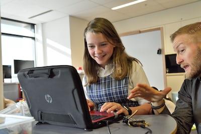 smiling woman using HP laptp
