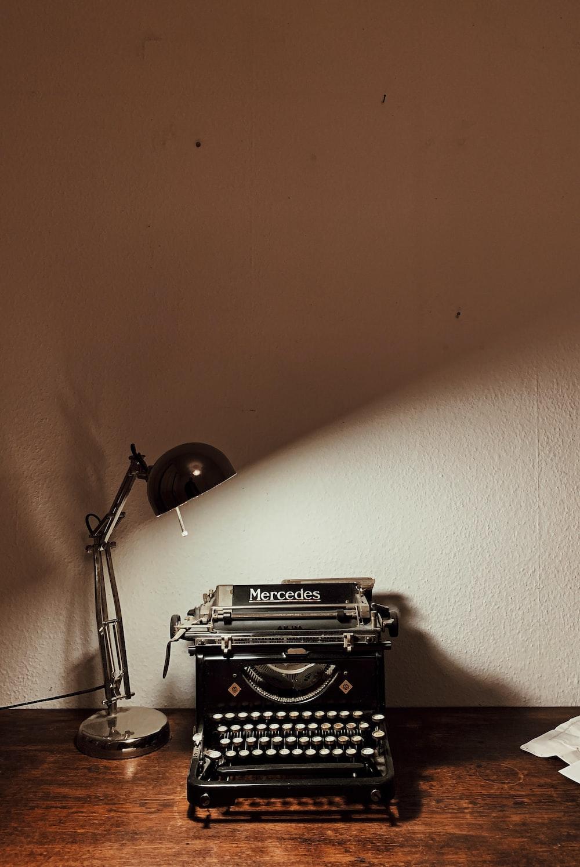 turned-on desk lamp near calculator