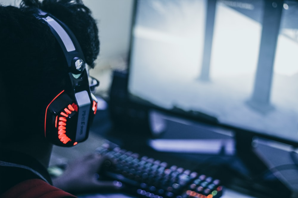 person wearing orange and black headphones