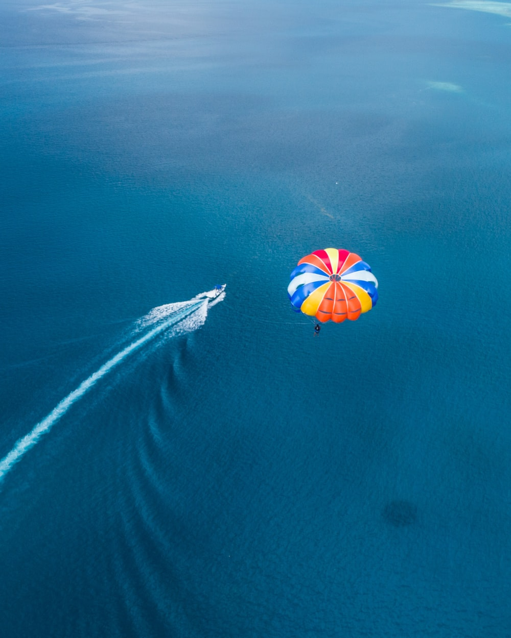 aerial photo of parachute above sea