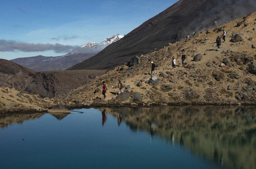 people walking near lake