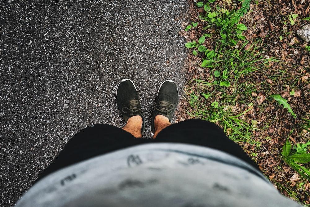 man wearing black shoes
