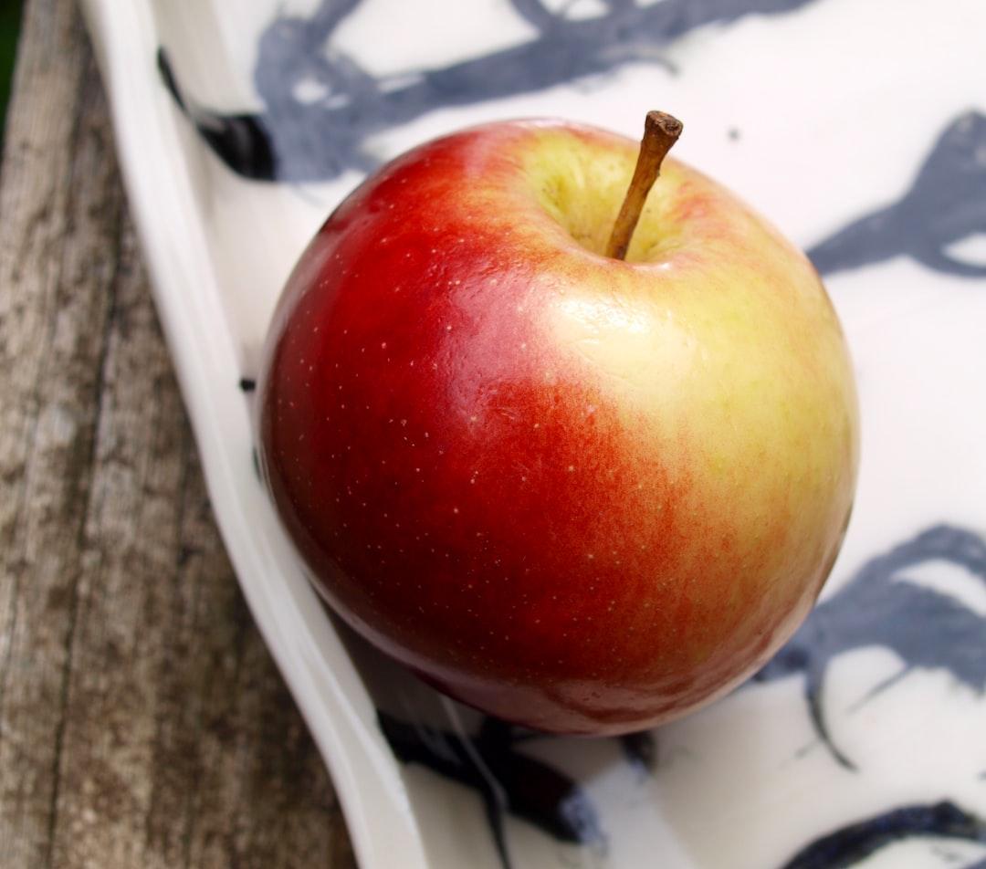 Gala apple on a hand-made porcelain platter.