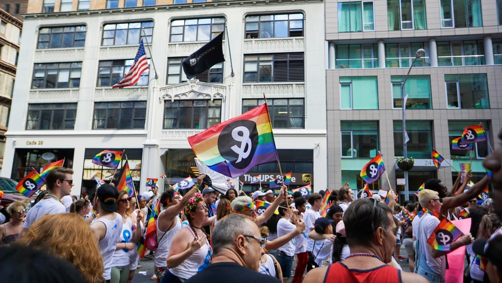 people holding pride flag