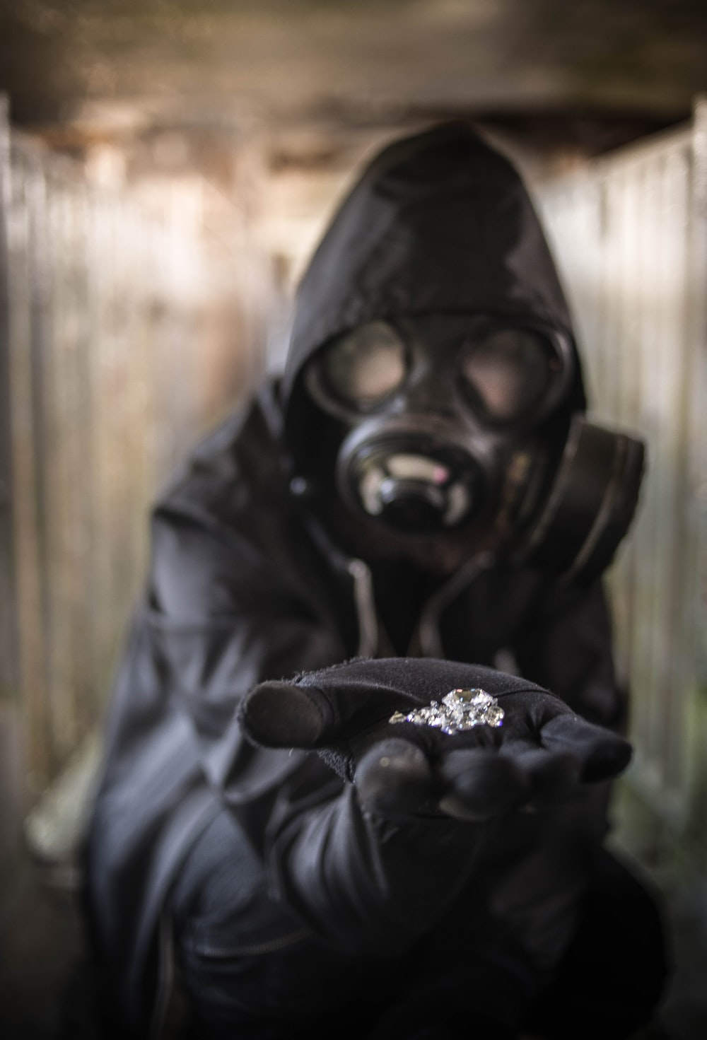 person wearing a gas-mask close-up photography