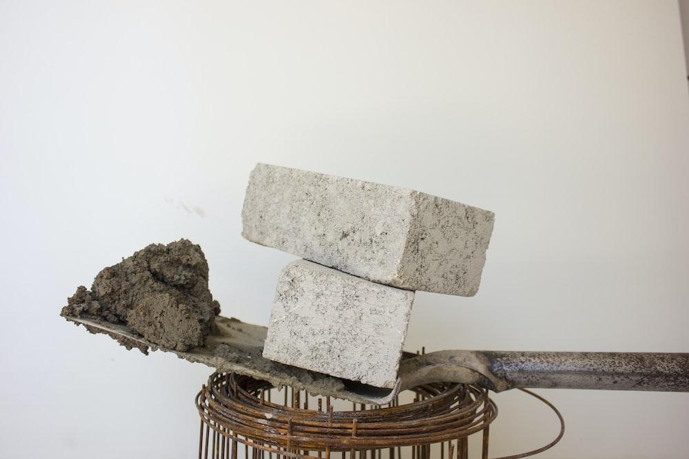 two gray blocks on shovel