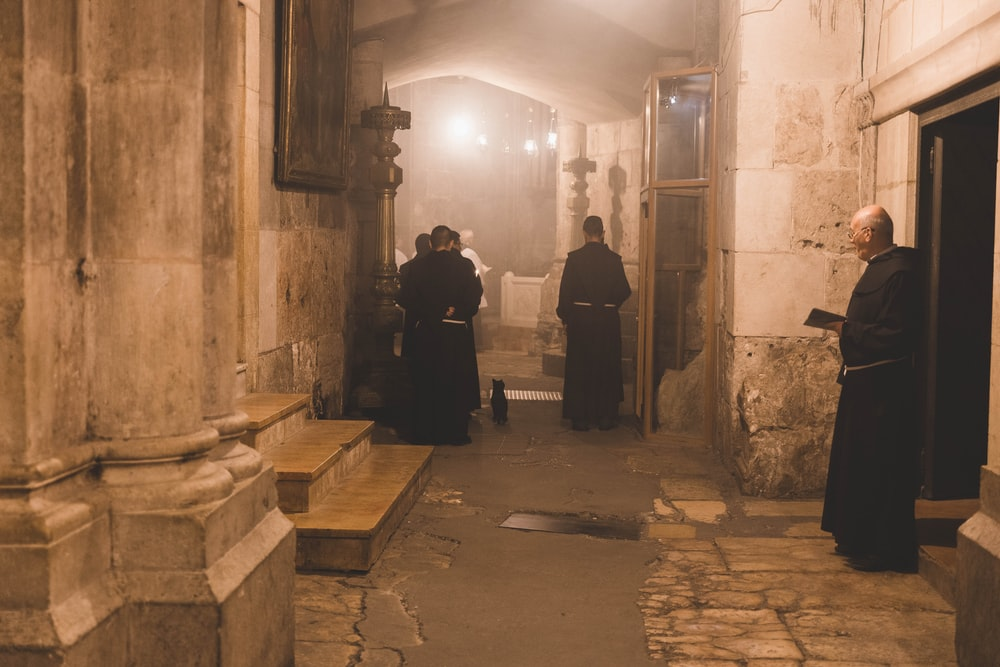 priests standing in well-lit room