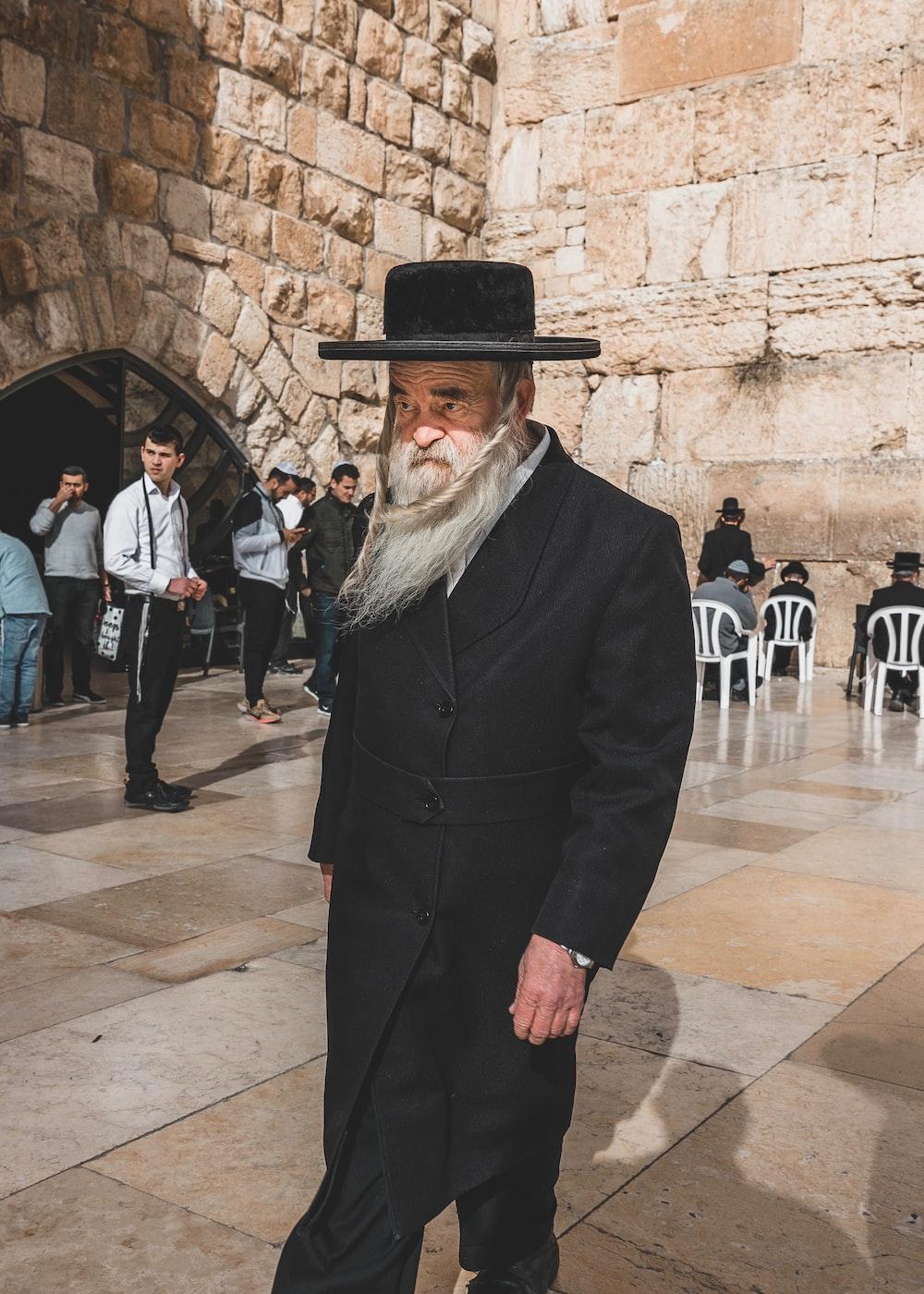man wearing black coat