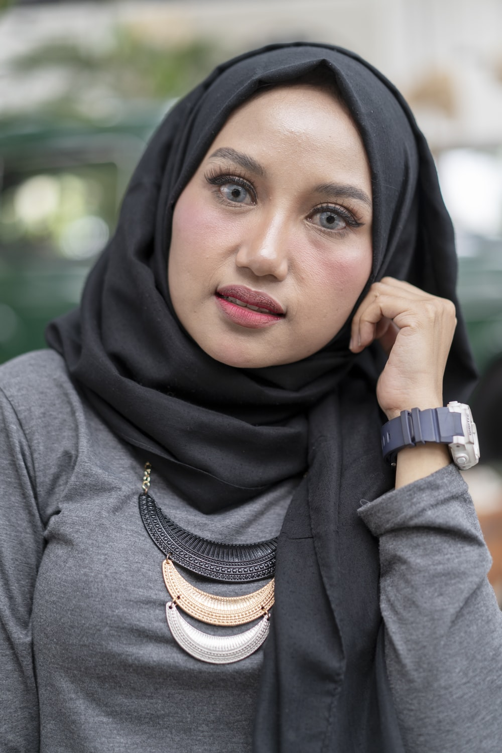 woman wearing gray long-sleeved top and black hijab