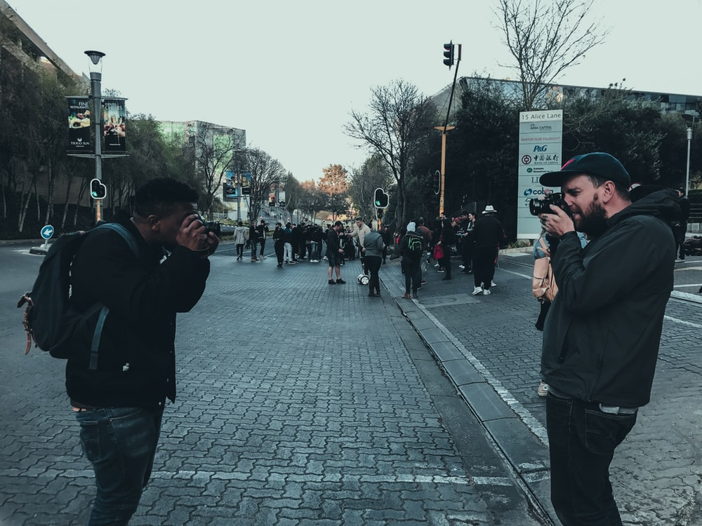 two men taking photo each other