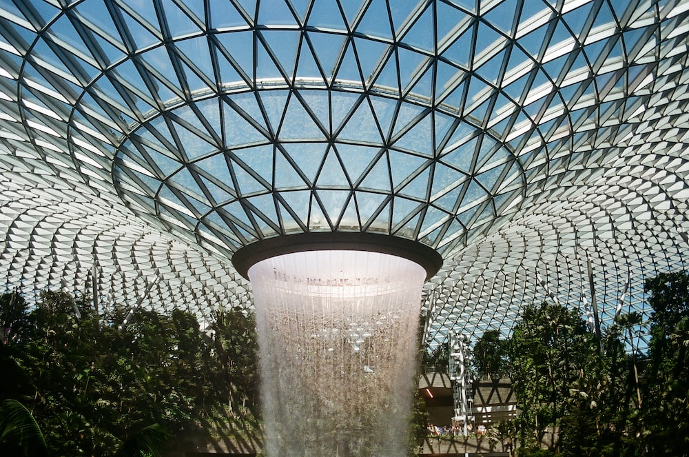 waterfalls in clear glass domed building