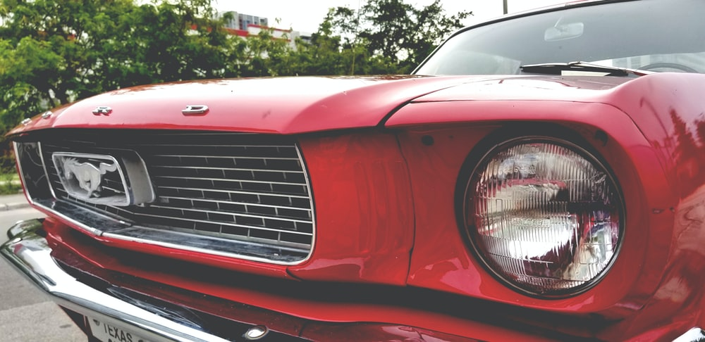red Ford Mostang closeup photography