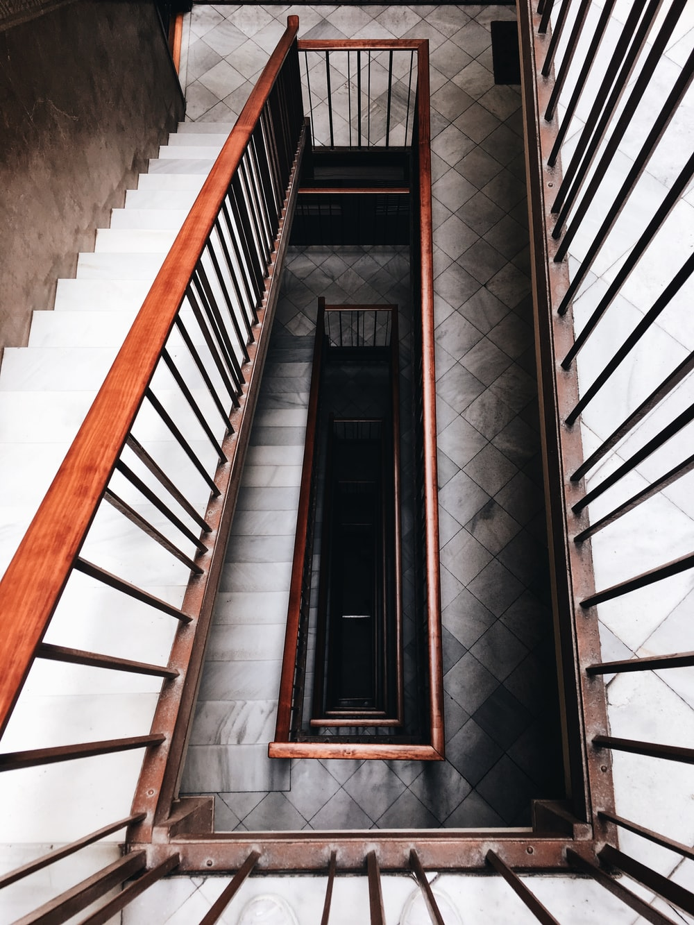high-angle photo of black and white staircase