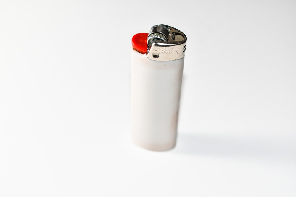 white disposable lighter