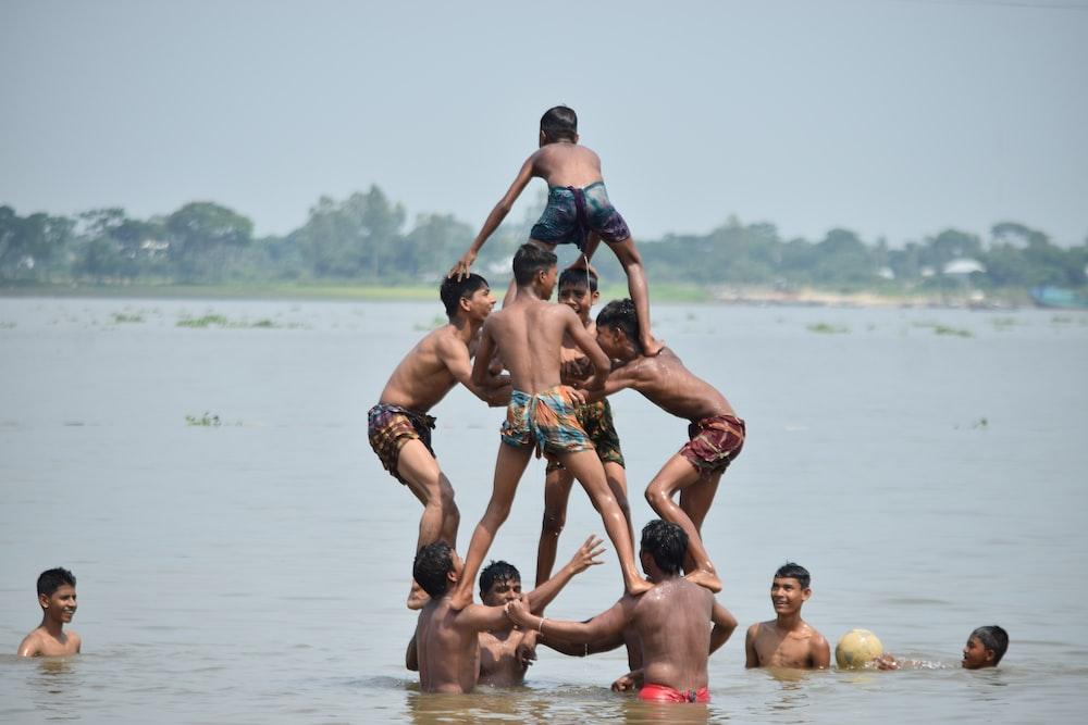 children forming a pyramid on a beach