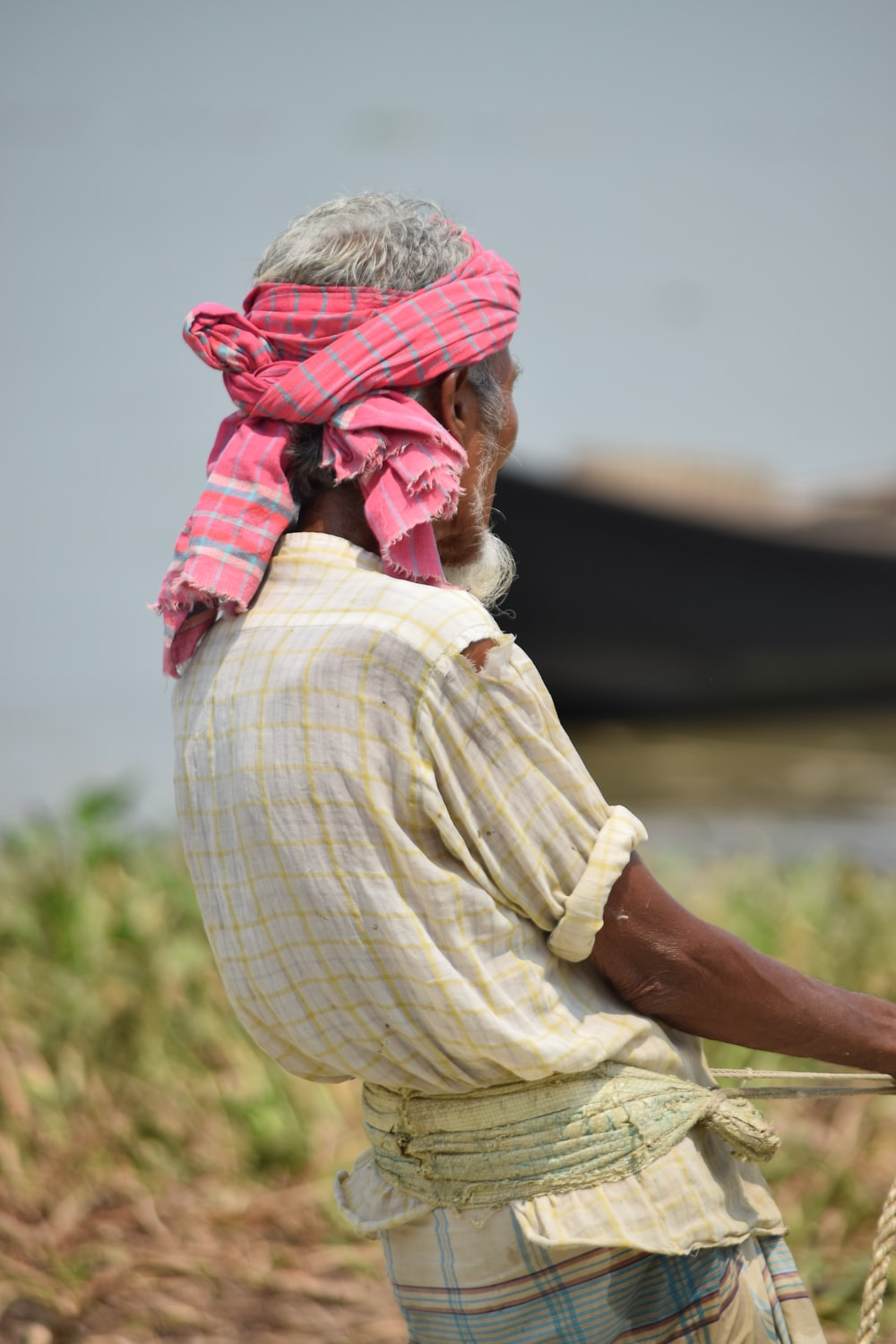 man in pink headscarf