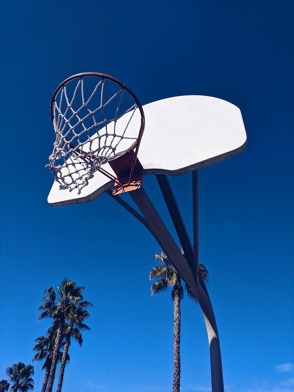black and white basketball system across blue sky