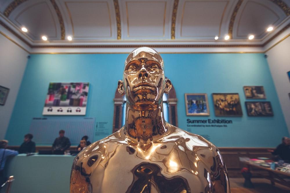 gold man statue