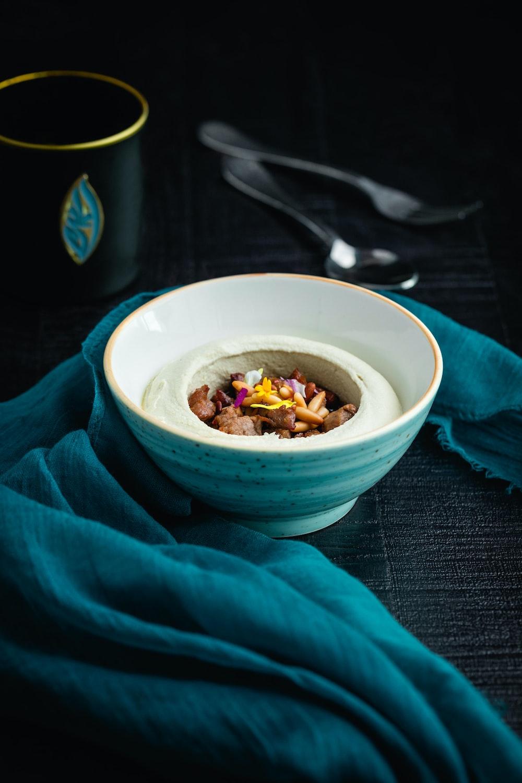 round white bowl on black textile