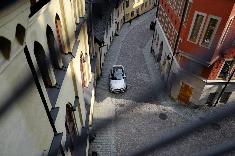 aerial view of grey vehicle beside building