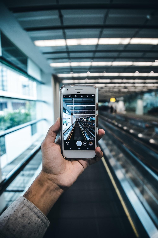 person holding white smartphone