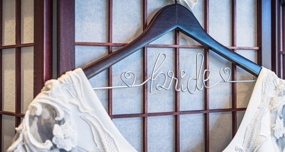 white dress hanged on black hanger