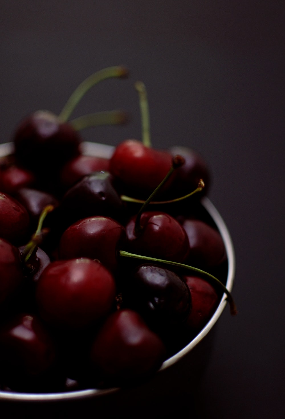 shallow focus photo of red cherries