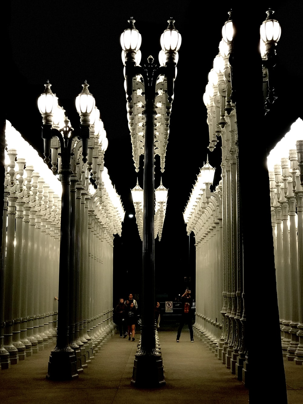 people walking near lighted posts