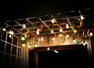 powered-on light bulbs on ceiling