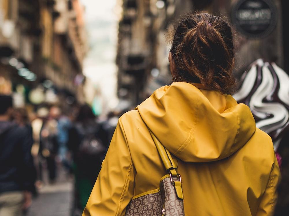 woman wearing jacket and bag