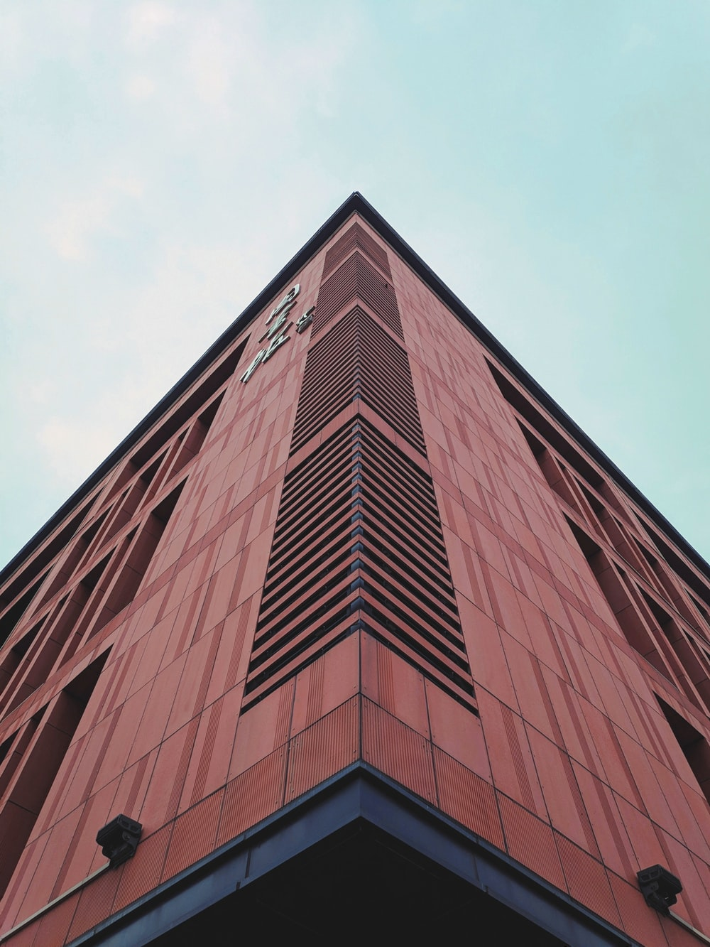 low-angle photography of brown building