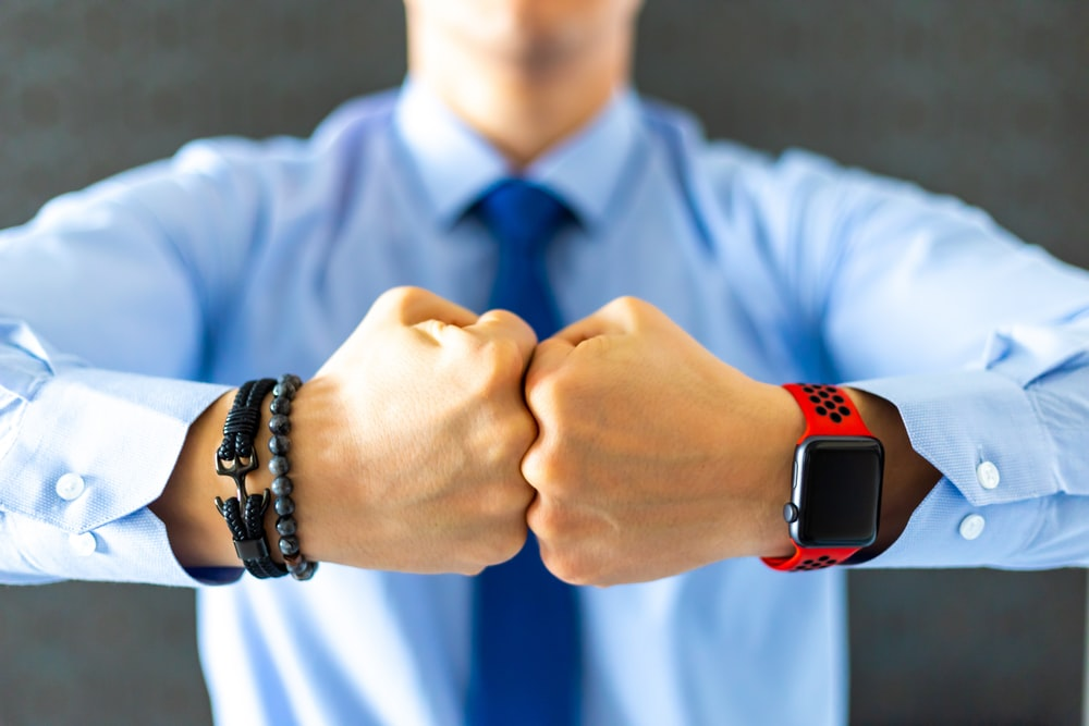 shallow focus photo of person wearing black smartwatch