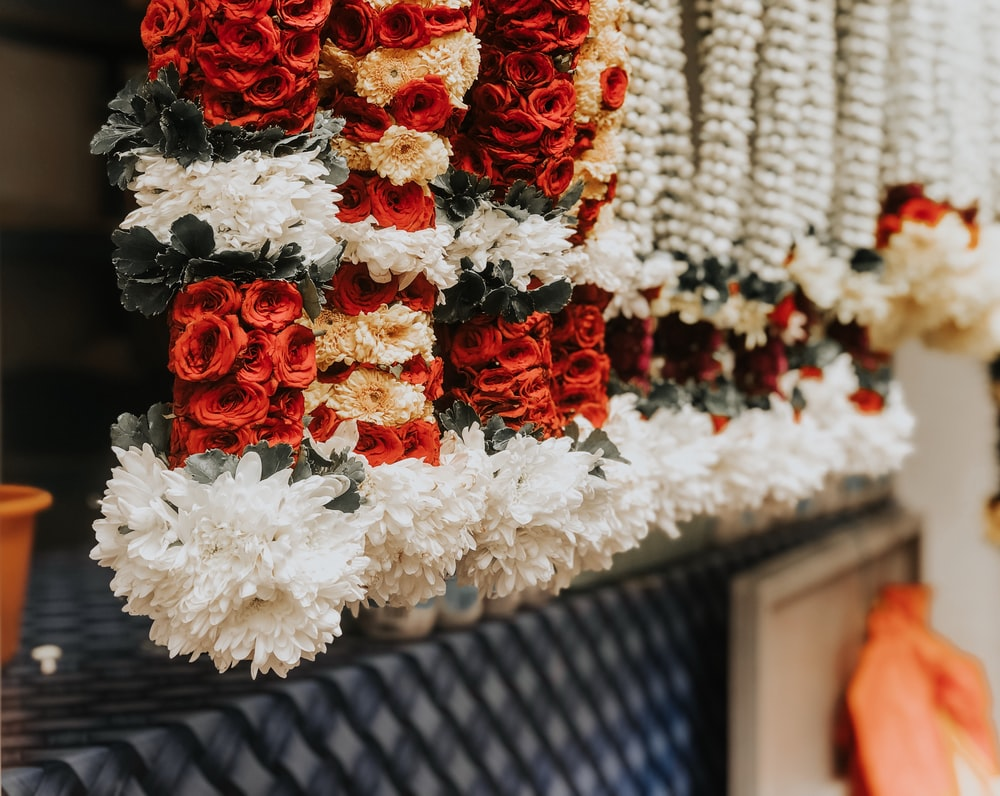 multicolored floral garlands on display