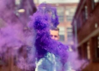 shallow focus photo of purple smoke