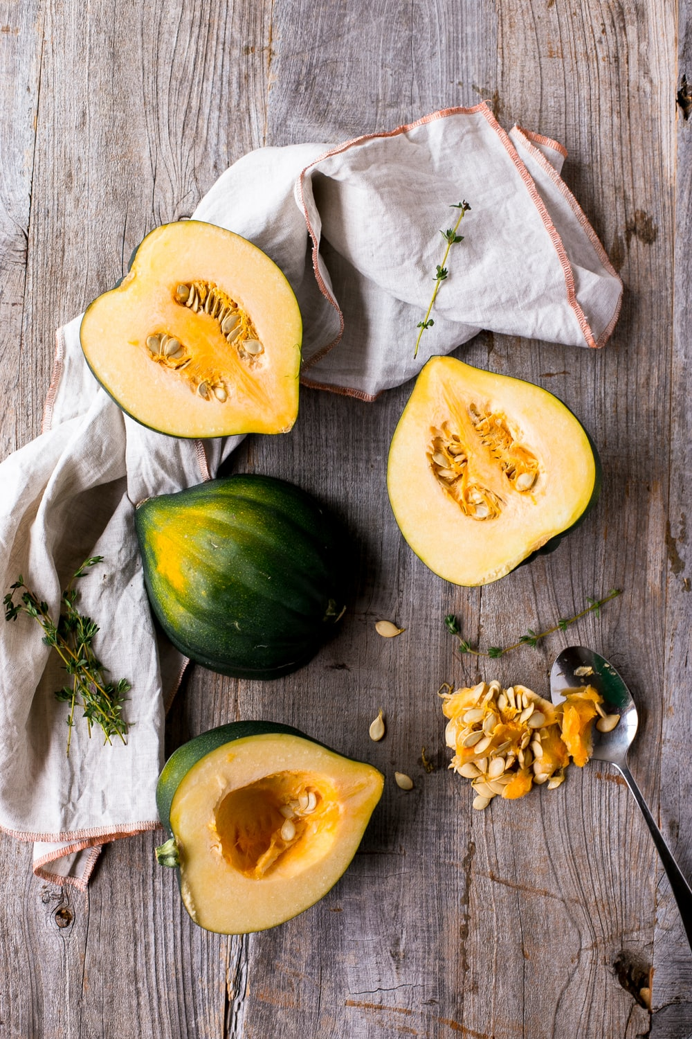 green and yellow squash on brown surface