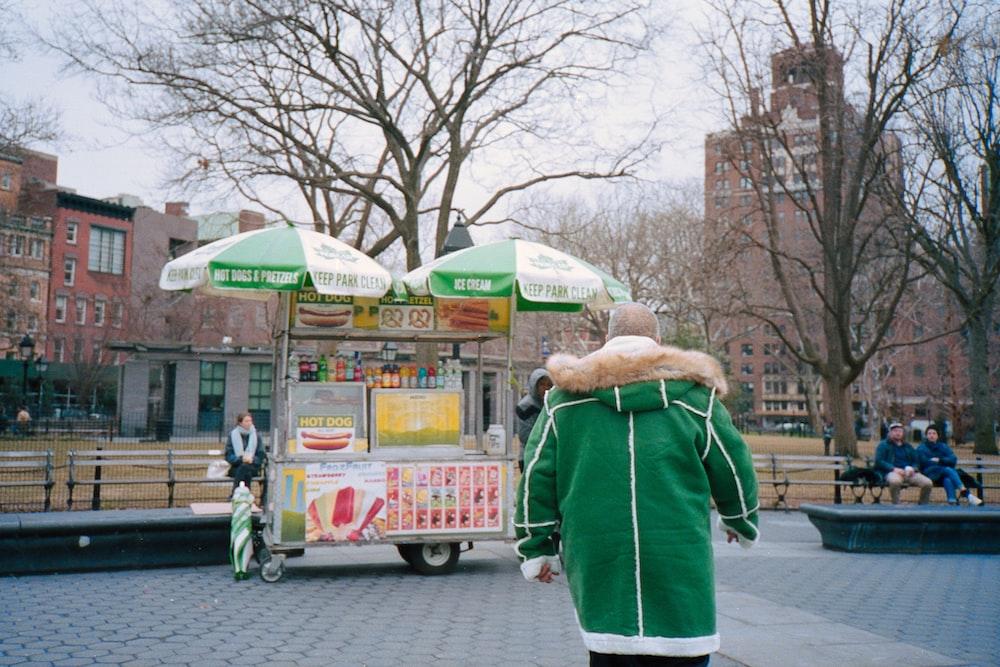 person wearing green jacket