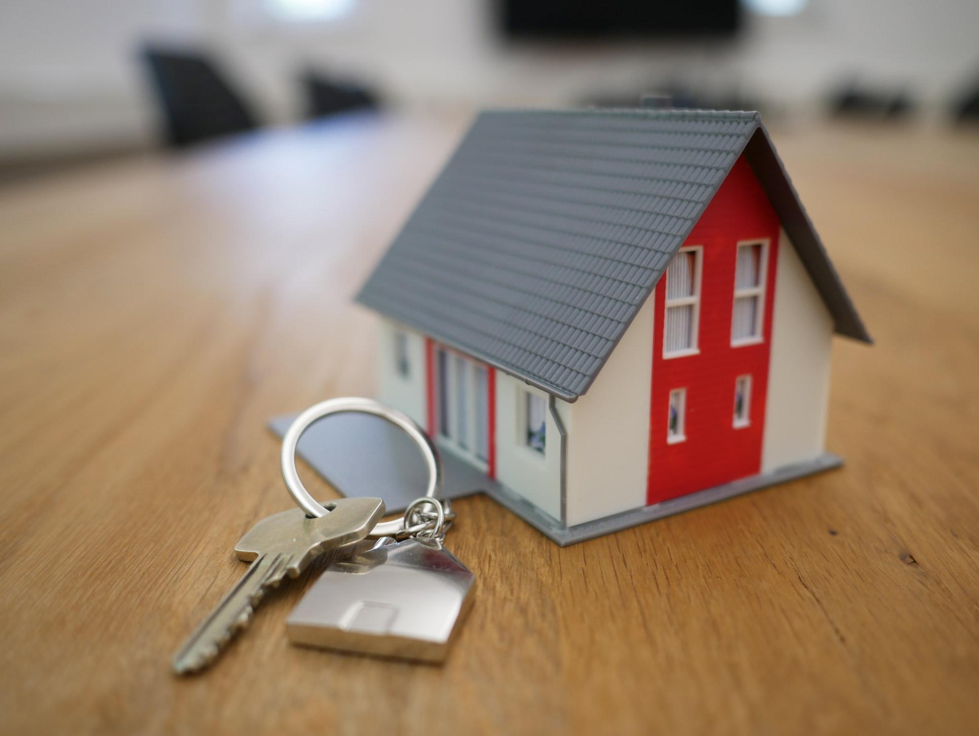 Miniature house figure with keys