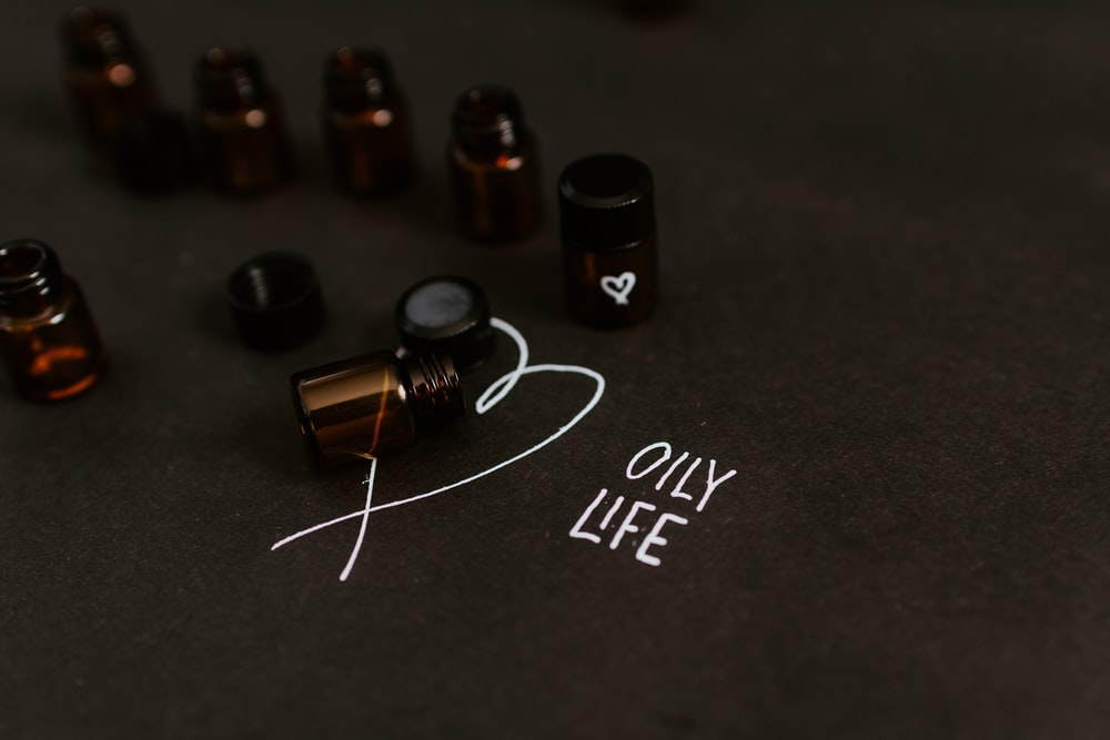 seven small bottle in black surface close-up photography How To Stay Calm During Stressful Situations